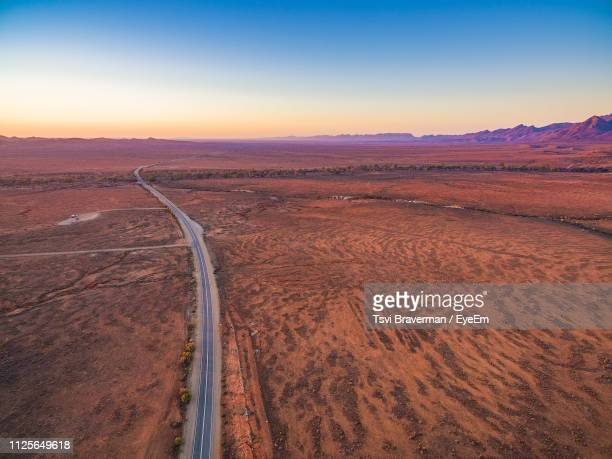 scenic view of land against sky during sunset - south australia stock photos and pictures