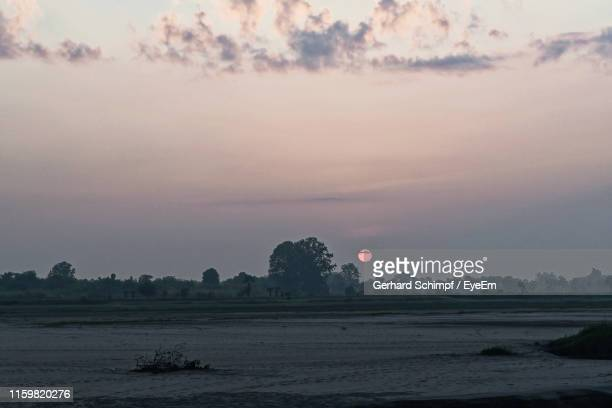 scenic view of land against sky during sunset - gerhard schimpf stock pictures, royalty-free photos & images