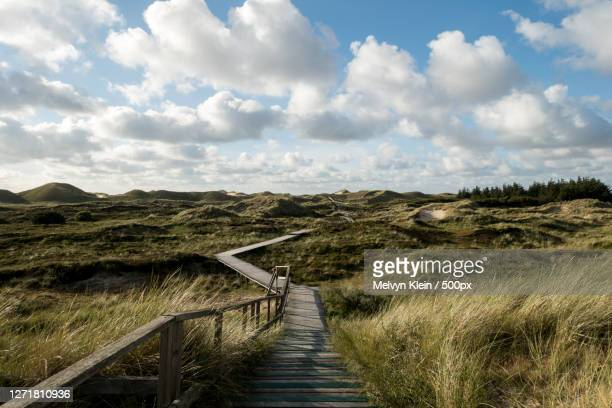 scenic view of land against sky, norddorf, germany - klein foto e immagini stock