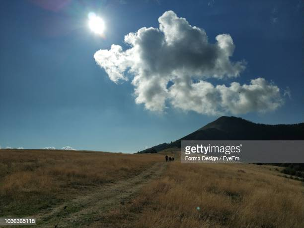 scenic view of land against sky - forma stock pictures, royalty-free photos & images