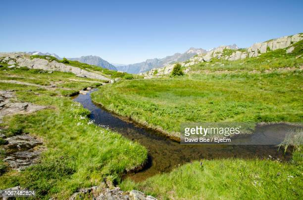 scenic view of land against sky - rhone alpes stock photos and pictures