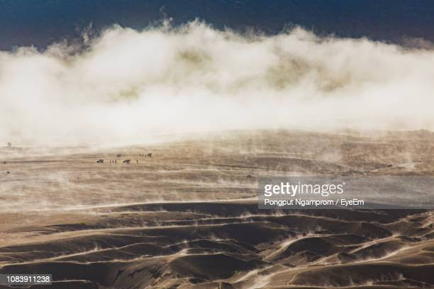 scenic view of land against sky - tengger stock pictures, royalty-free photos & images