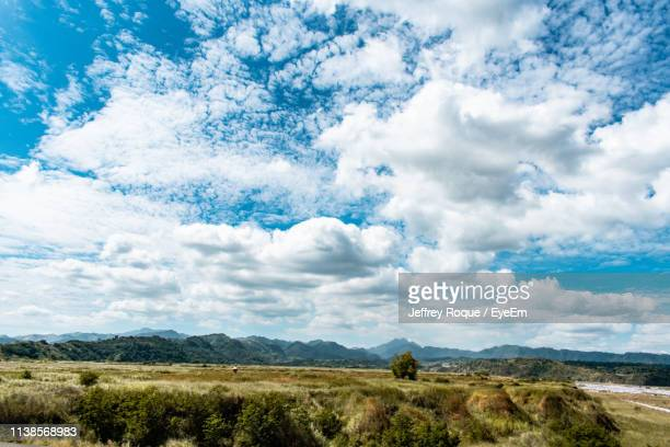 scenic view of land against sky - jeffrey roque stock photos and pictures