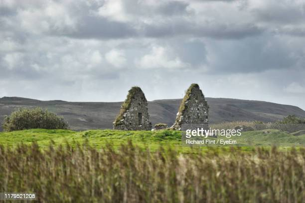 scenic view of land against sky - richard flint stock pictures, royalty-free photos & images