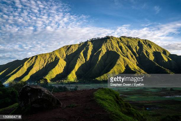 scenic view of land against sky - bandung stock pictures, royalty-free photos & images