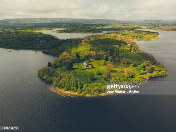 scenic view of land against sky - cavan images foto e immagini stock