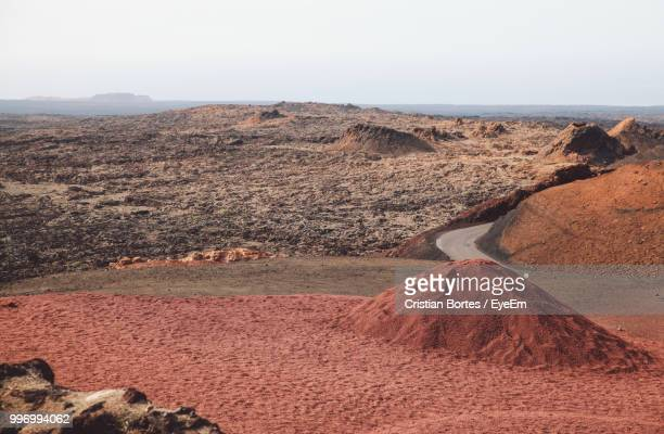 scenic view of land against sky - arrecife stock photos and pictures