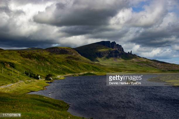 scenic view of land and mountains against sky - storm dennis stock pictures, royalty-free photos & images