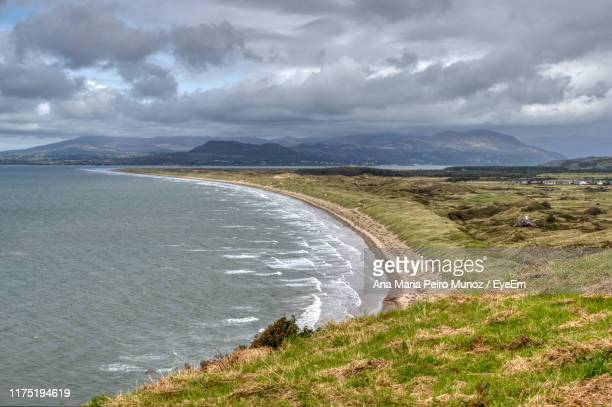 scenic view of land and sea against sky - non urban scene stock pictures, royalty-free photos & images