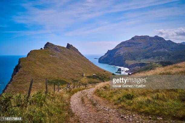 scenic view of land by sea against sky - camino de santiago stock pictures, royalty-free photos & images