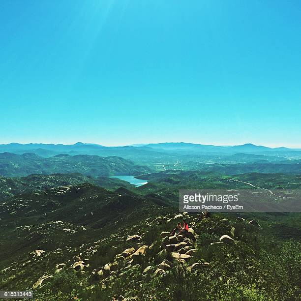 scenic view of landscape against blue sky - alisson stock pictures, royalty-free photos & images