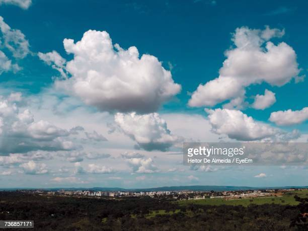 scenic view of landscape against blue sky - nuvens fofas imagens e fotografias de stock