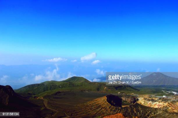 scenic view of landscape against blue sky - tottori prefecture stock photos and pictures