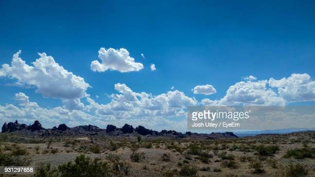 scenic view of landscape against blue sky - josh utley stock pictures, royalty-free photos & images