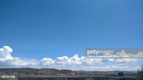 Scenic View Of Landscape Against Blue Sky