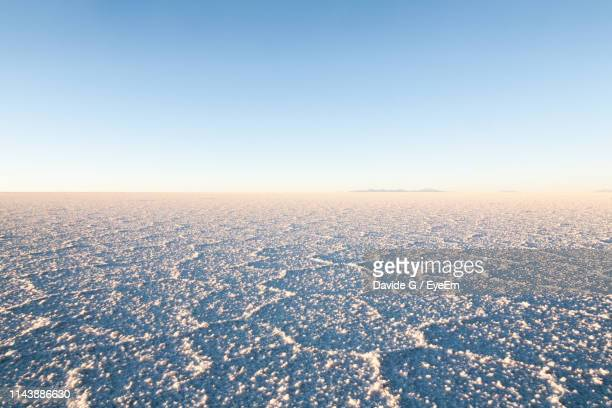 scenic view of landscape against clear blue sky - ウユニ ストックフォトと画像