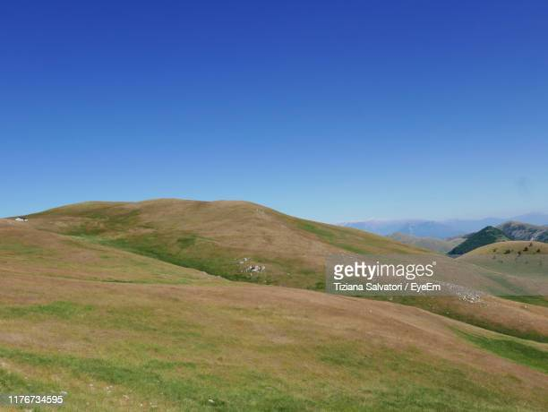 scenic view of landscape against clear blue sky - カンポ・インペラトーレ ストックフォトと画像