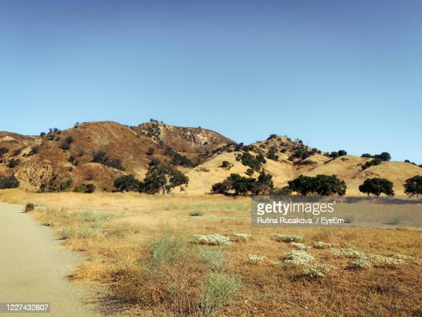 scenic view of landscape against clear blue sky - calabasas stock pictures, royalty-free photos & images