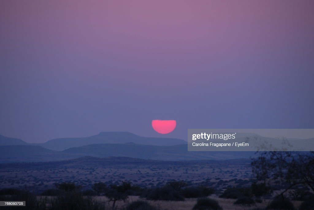 Scenic View Of Landscape Against Clear Sky At Sunset : Foto stock