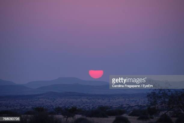scenic view of landscape against clear sky at sunset - carolina fragapane stock pictures, royalty-free photos & images