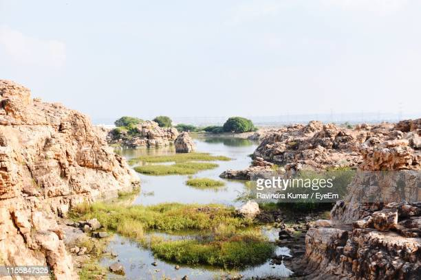 scenic view of landscape against clear sky - テランガナ州 ストックフォトと画像
