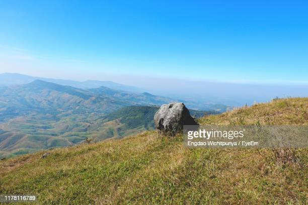 scenic view of landscape against clear sky - boulder rock stock pictures, royalty-free photos & images