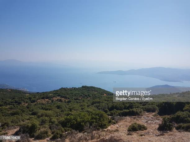 scenic view of landscape against clear sky - volos stock pictures, royalty-free photos & images