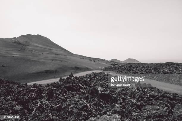 scenic view of landscape against clear sky - bortes fotografías e imágenes de stock