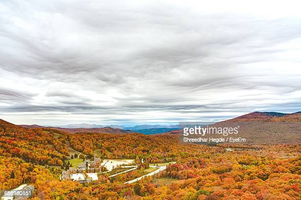 Scenic View Of Landscape Against Cloudy Sky During Autumn