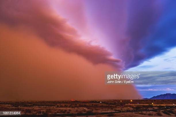 scenic view of landscape against cloudy sky during sunset - dust storm stock pictures, royalty-free photos & images