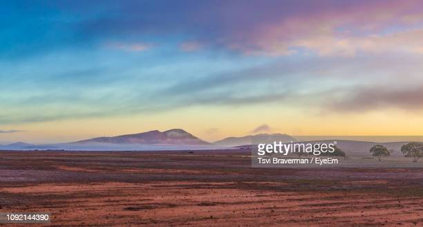 scenic view of landscape against cloudy sky during sunset - south australia stock pictures, royalty-free photos & images