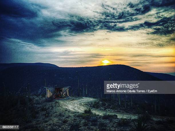 scenic view of landscape against cloudy sky during sunset - puebla mexico stock pictures, royalty-free photos & images