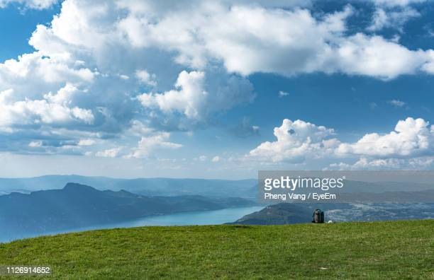 scenic view of landscape against cloudy sky - savoie stock pictures, royalty-free photos & images