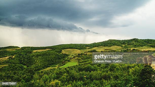 scenic view of landscape against cloudy sky - file:the_wyoming,_orlando,_fl.jpg stock pictures, royalty-free photos & images
