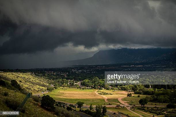 scenic view of landscape against cloudy sky - dave faulkner eye em stock pictures, royalty-free photos & images