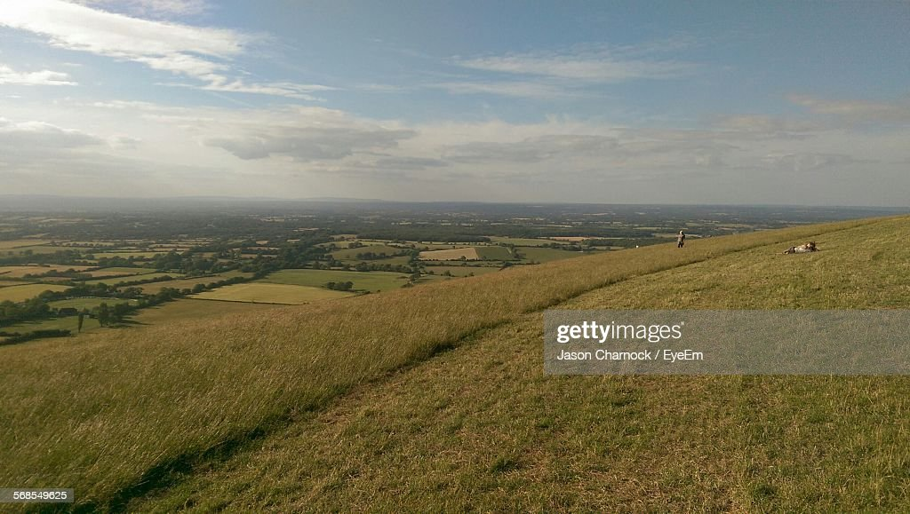 Scenic View Of Landscape Against Cloudy Sky : Stock Photo