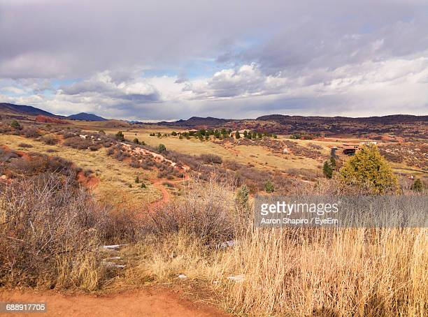 scenic view of landscape against cloudy sky - gras stock pictures, royalty-free photos & images