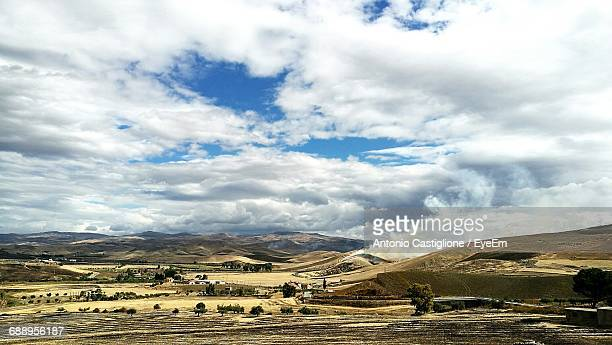 scenic view of landscape against cloudy sky - province of caltanissetta stock photos and pictures