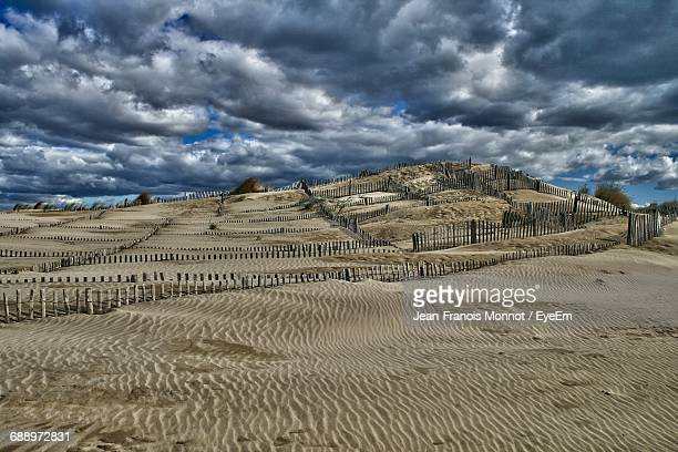 scenic view of landscape against cloudy sky - サントマリードラメール ストックフォトと画像