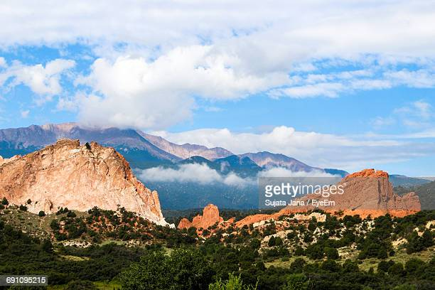 scenic view of landscape against cloudy sky - colorado springs stock pictures, royalty-free photos & images