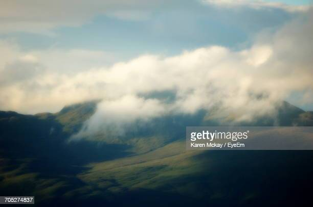scenic view of landscape against cloudy sky - karen mckay stock photos and pictures