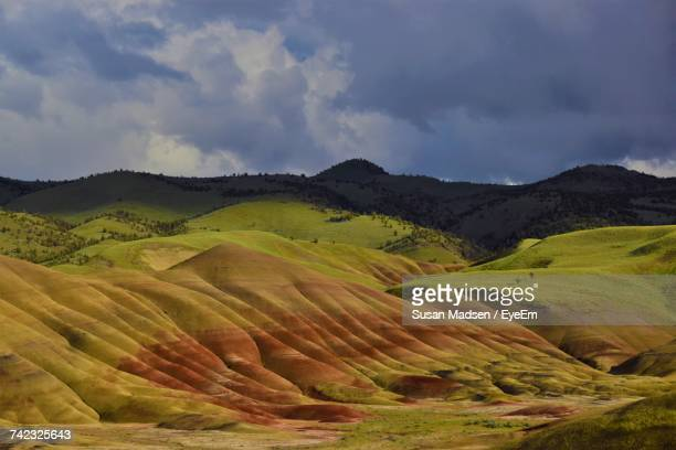 scenic view of landscape against cloudy sky - fossil site stock pictures, royalty-free photos & images