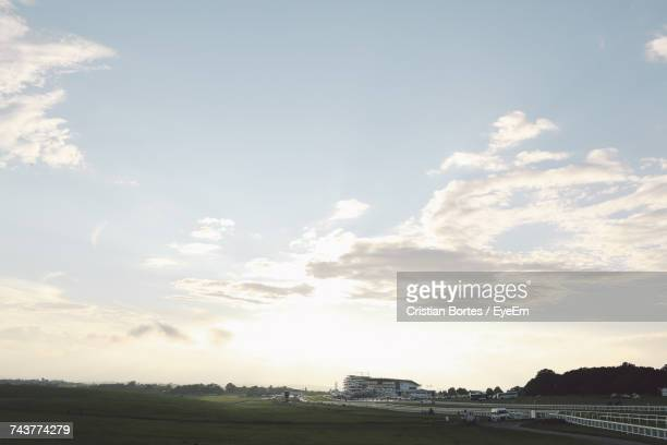 scenic view of landscape against cloudy sky - bortes stock photos and pictures
