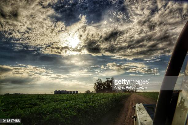 scenic view of landscape against cloudy sky - andres ruffo stock-fotos und bilder