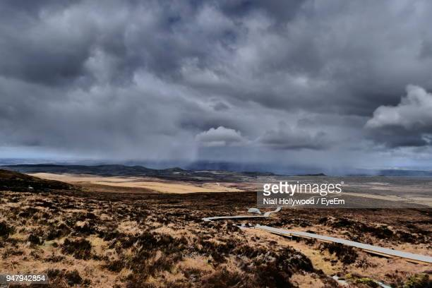 scenic view of landscape against cloudy sky - county fermanagh stock photos and pictures