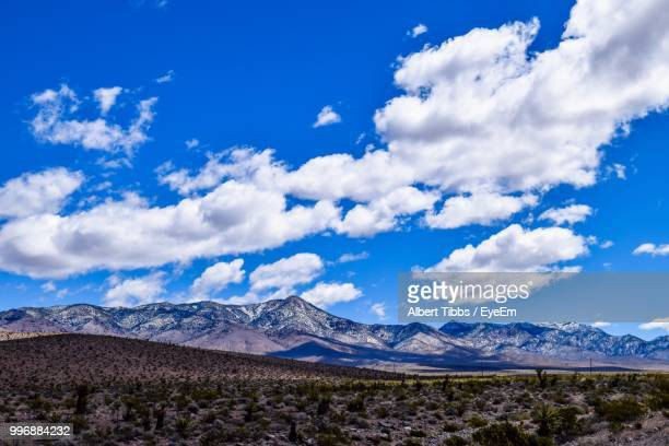 scenic view of landscape against cloudy sky - mt charleston stock photos and pictures