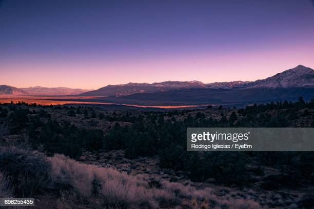 Scenic View Of Landscape Against Dramatic Sky At Sunset