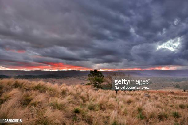 scenic view of landscape against dramatic sky during sunset - cordoba argentina fotografías e imágenes de stock