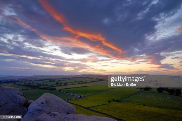 scenic view of landscape against dramatic sky during sunset - オトレイ ストックフォトと画像