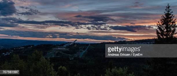scenic view of landscape against dramatic sky - eriksen foto e immagini stock